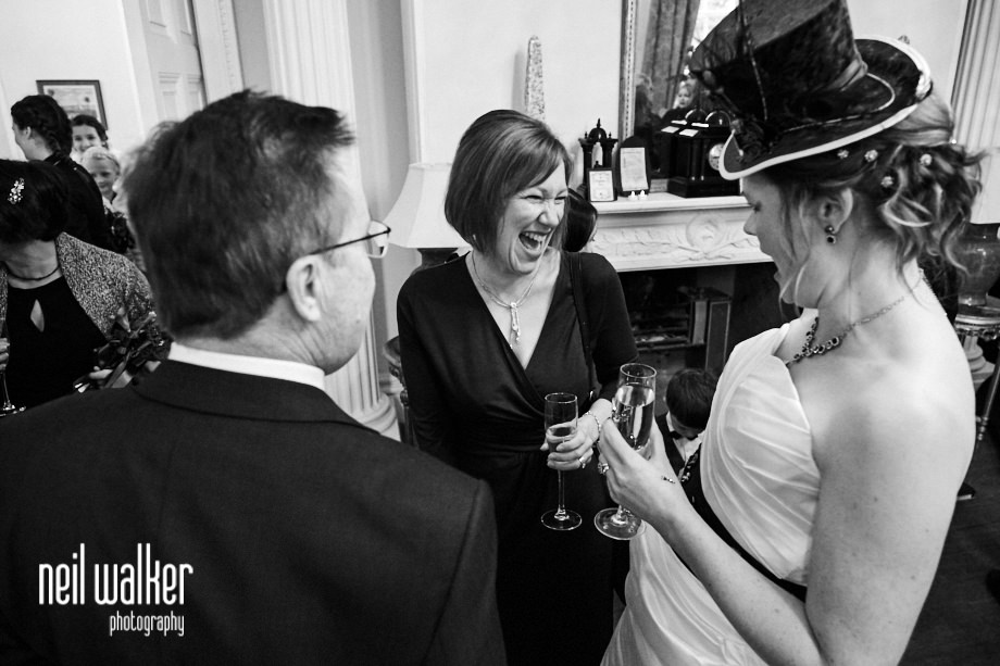 a guest laughs with the bride