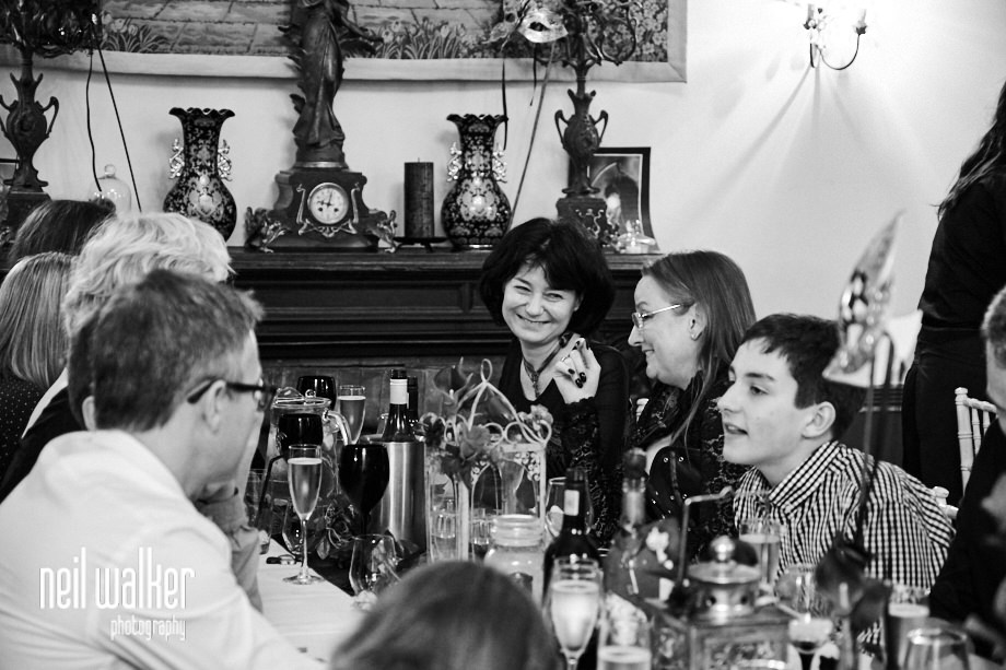 guests talking together during the wedding breakfast at Castle goring