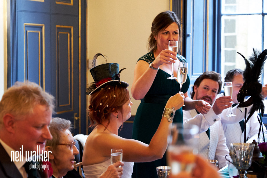 the chief bridesmaid raises a toast during her speech