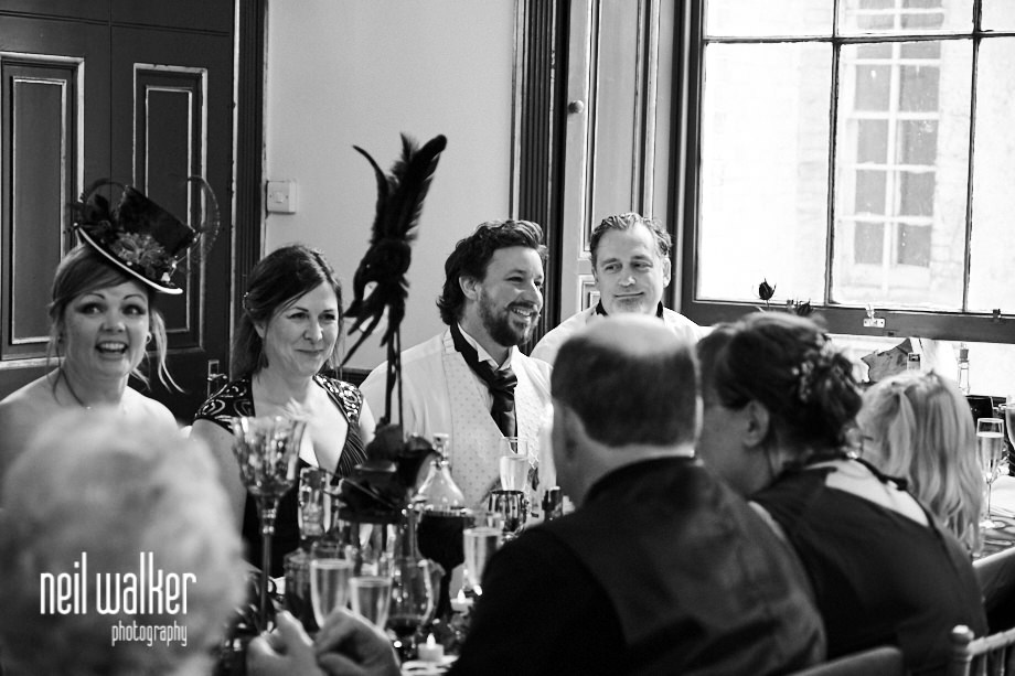 the best man laughs during the groom's speech