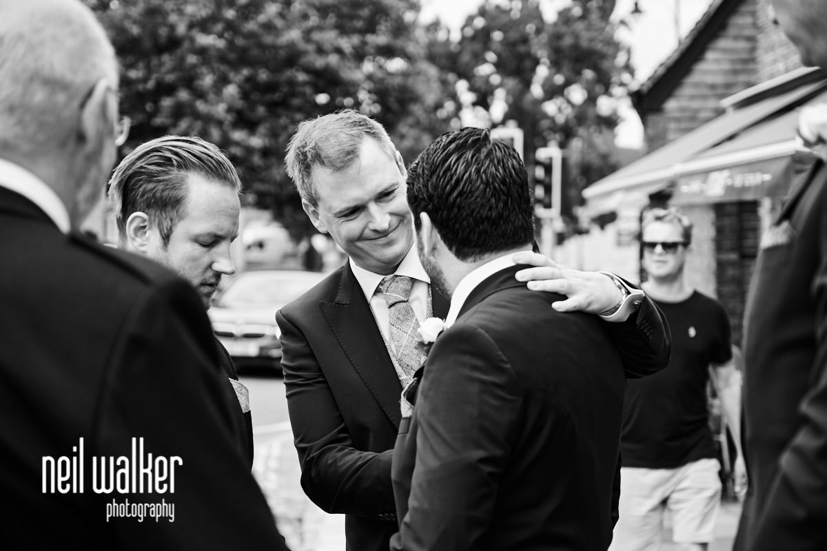 the groom embracing his best man