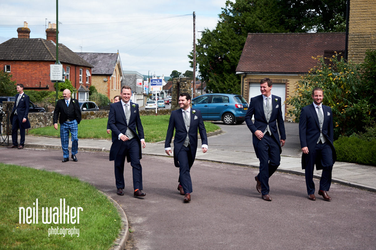 the groom and ushers arriving at the church