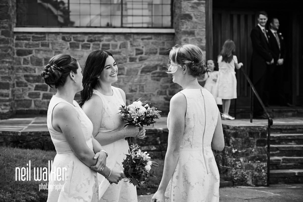 the bridesmaids laughing outside the church
