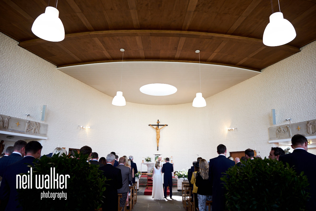 an interior photo of The Divine Motherhood and St Francis of Assisi Catholic Church, Bepton Road, Midhurst, GU29 9HD during a wedding