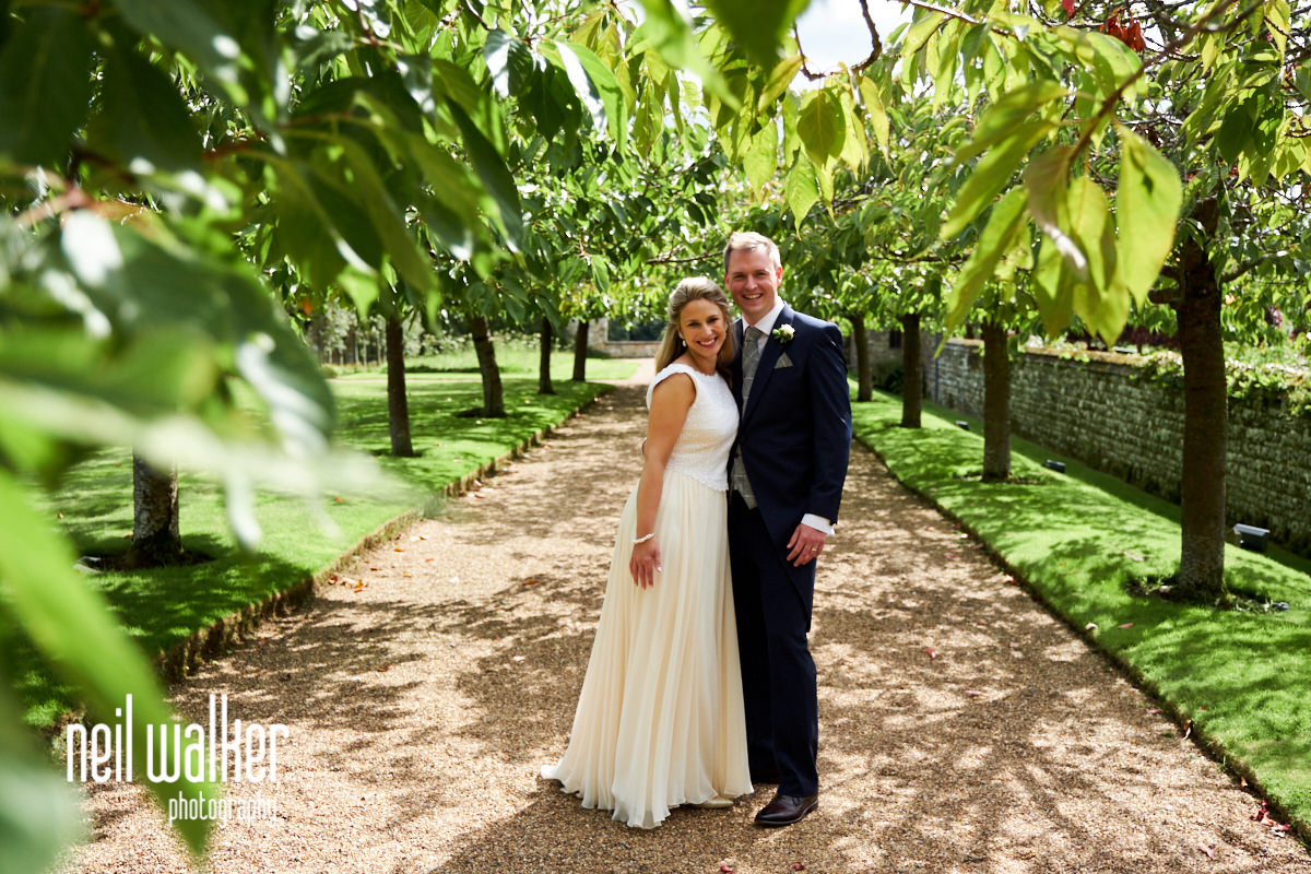 the bride and groom under a tree