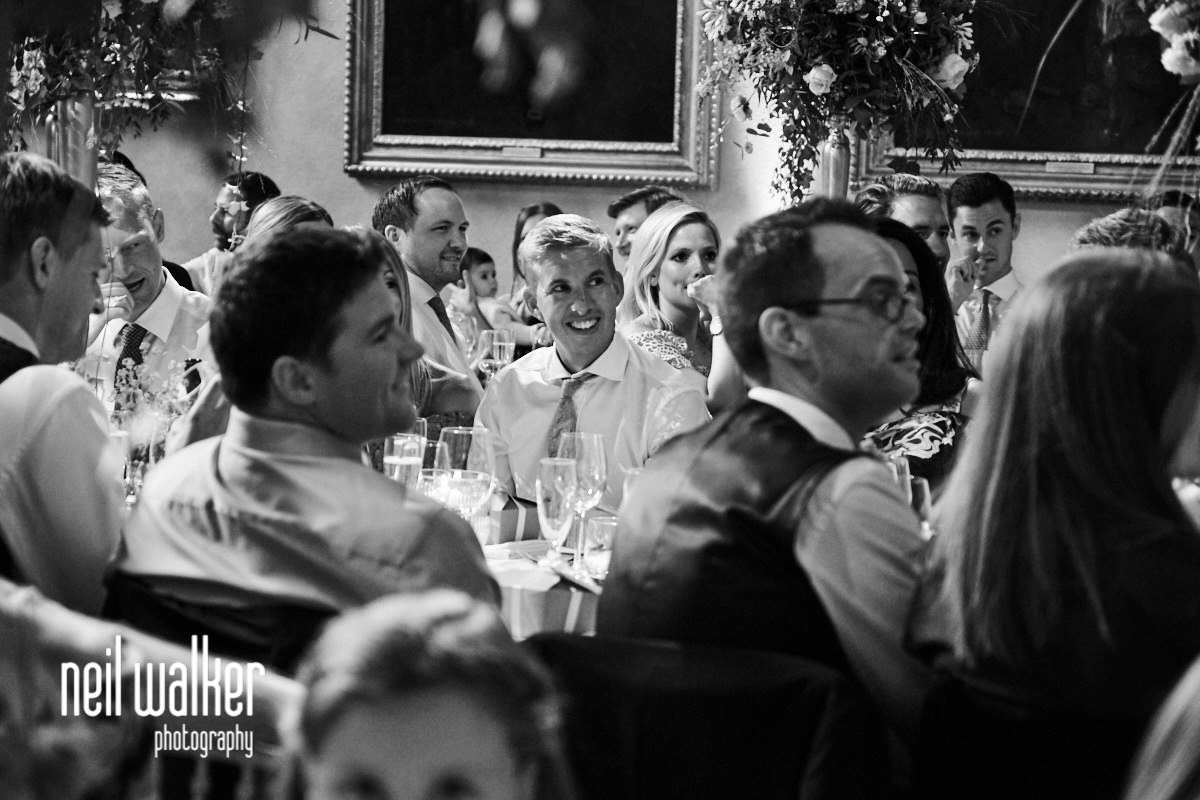 a guest laughing at the father of the bride speech