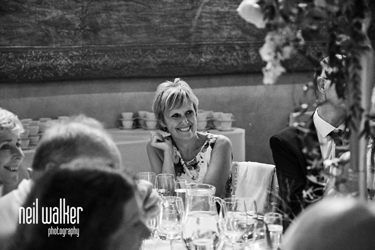 a guest smiling at the wedding speeches