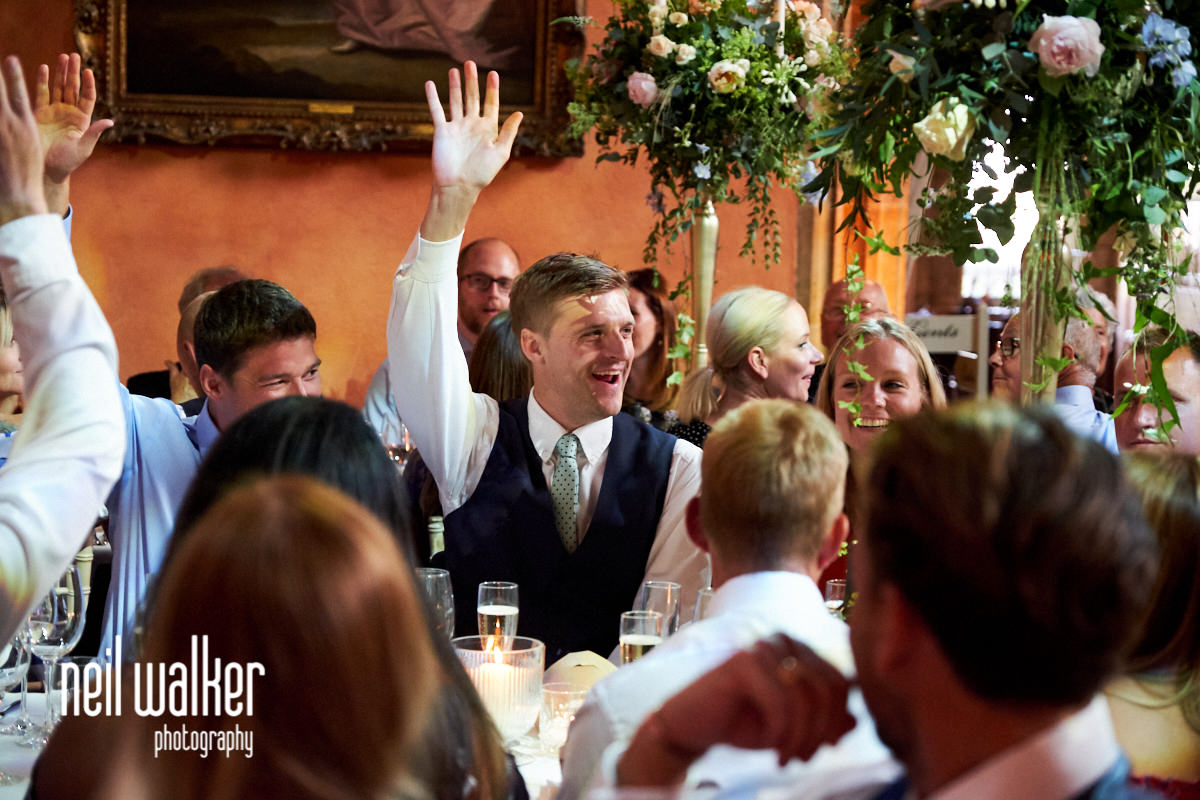 a guest raises his hand during the father of the bride speech
