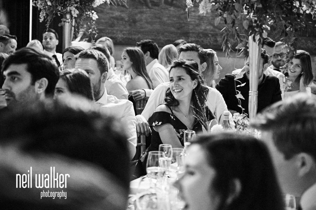 a guest smiling during a wedding a Cowdray House