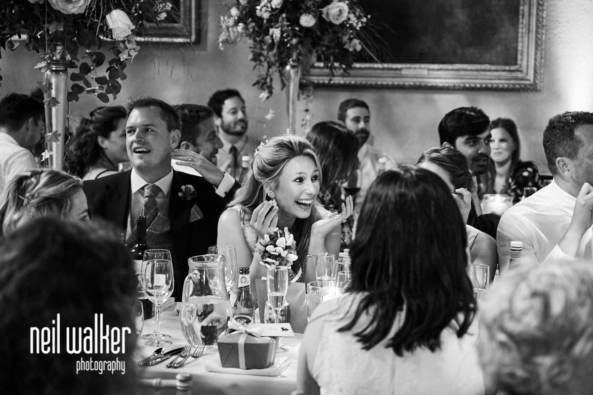 the bride laughing during the best man's speech