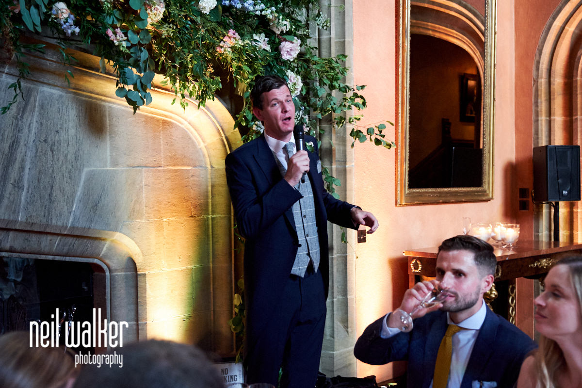 a groomsman does a speech at this Cowdray House wedding