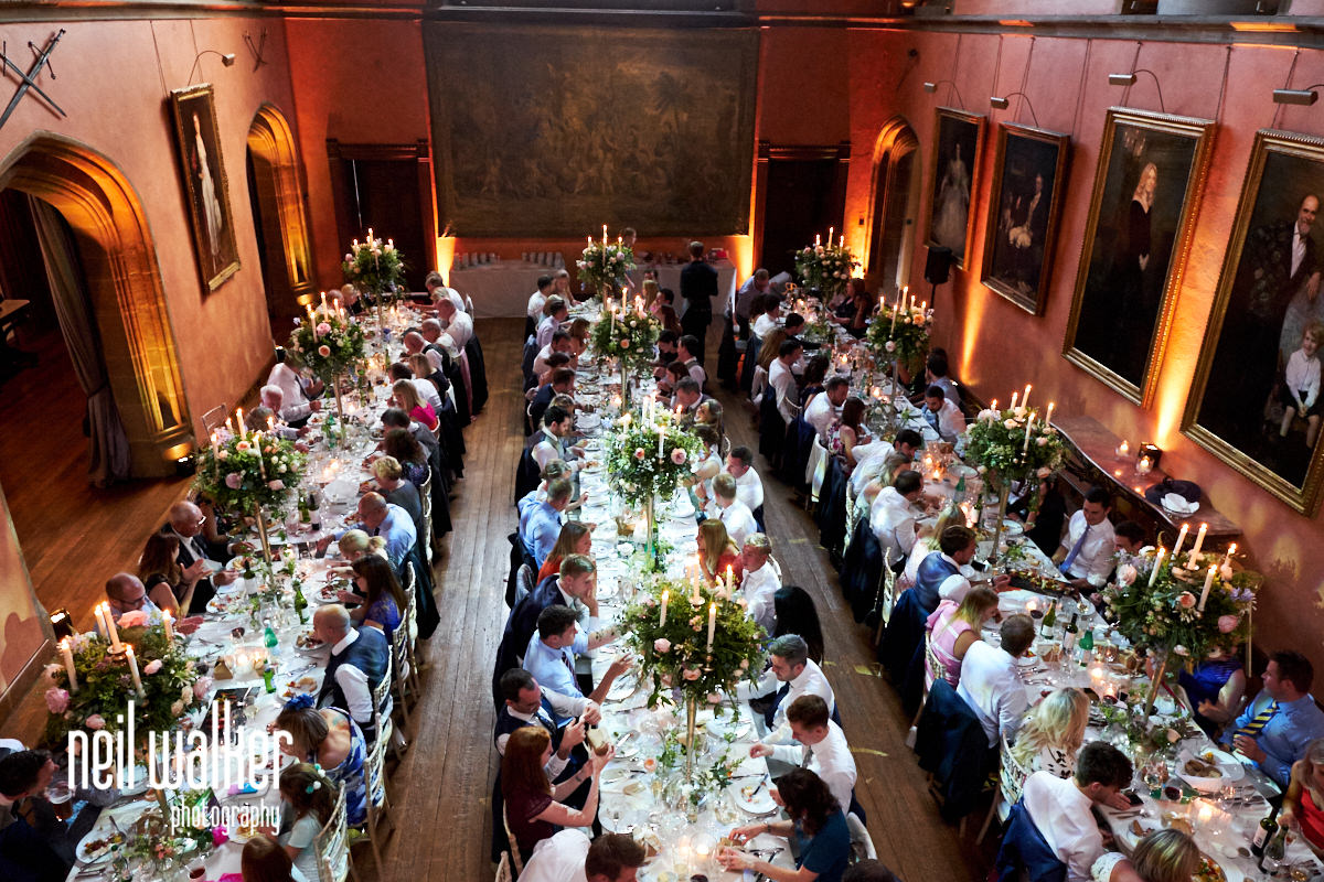 the hall at Cowdray House with guests enjoying a wedding