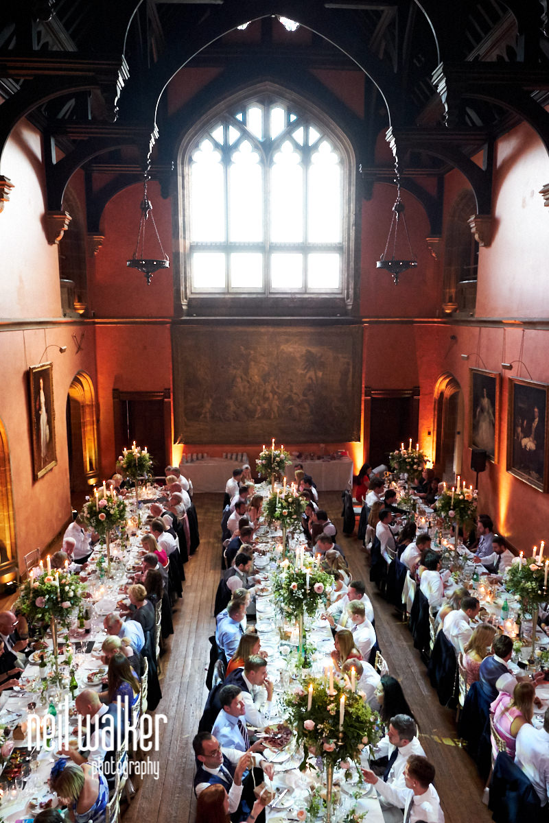 a wide view of the main hall at Cowdray House during a wedding