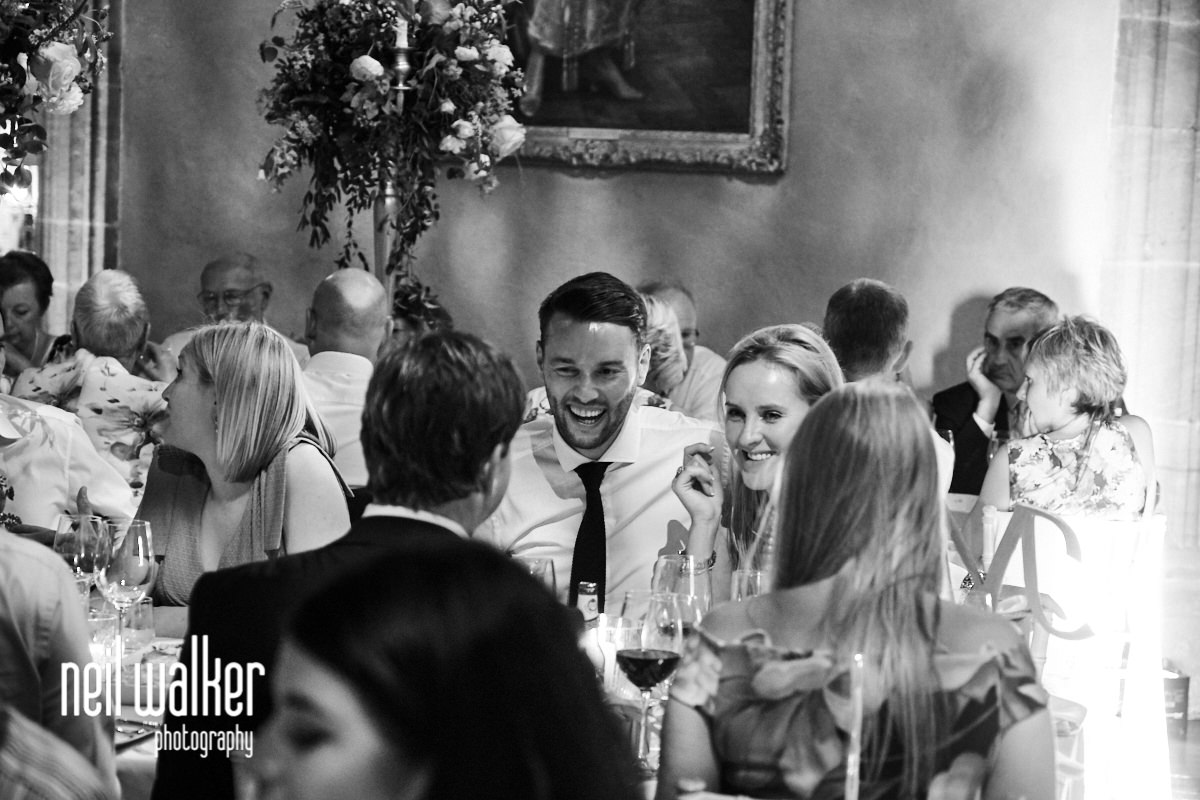 guests laughing during the wedding breakfast