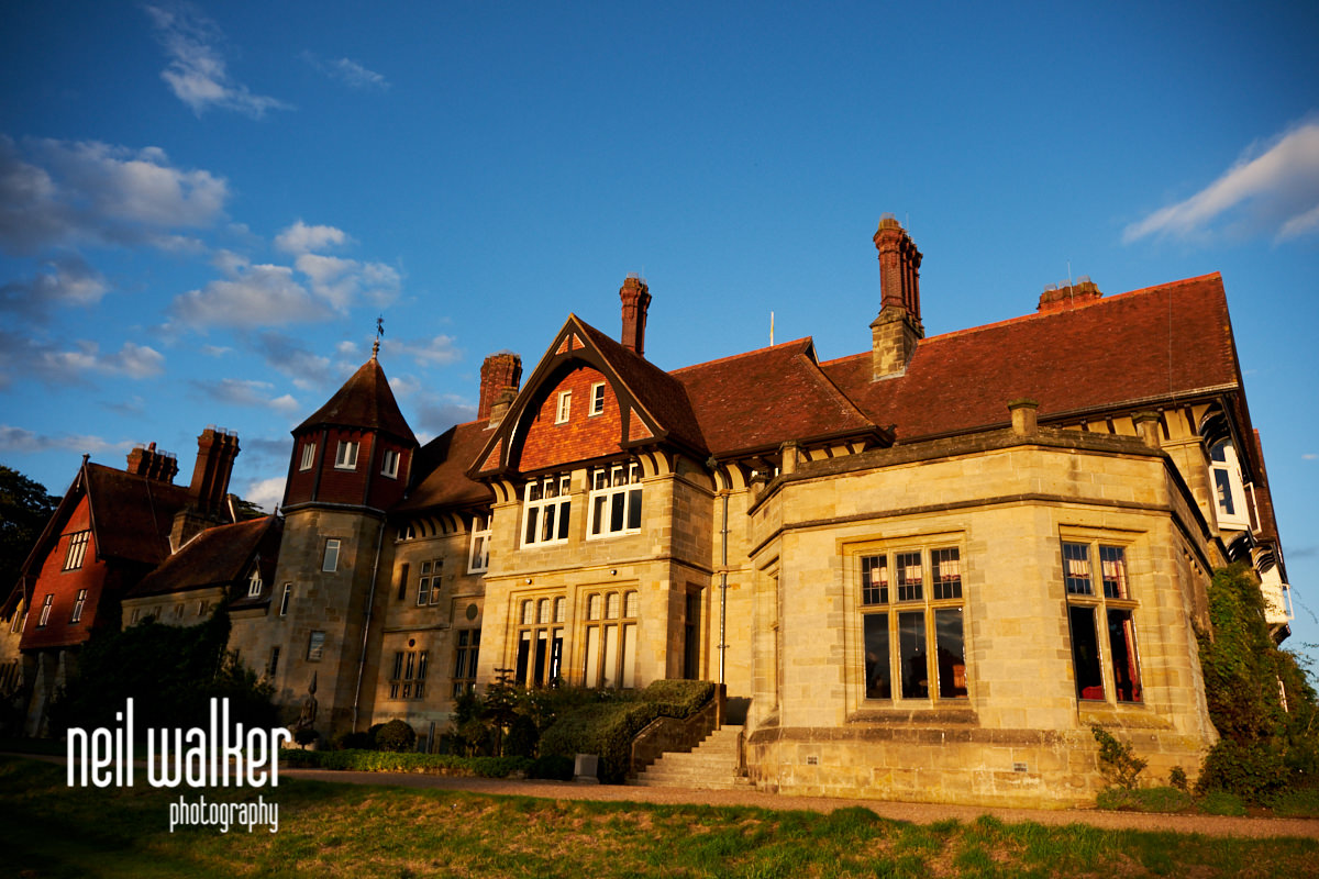 a rear exterior view of Cowdray House in the evening sun