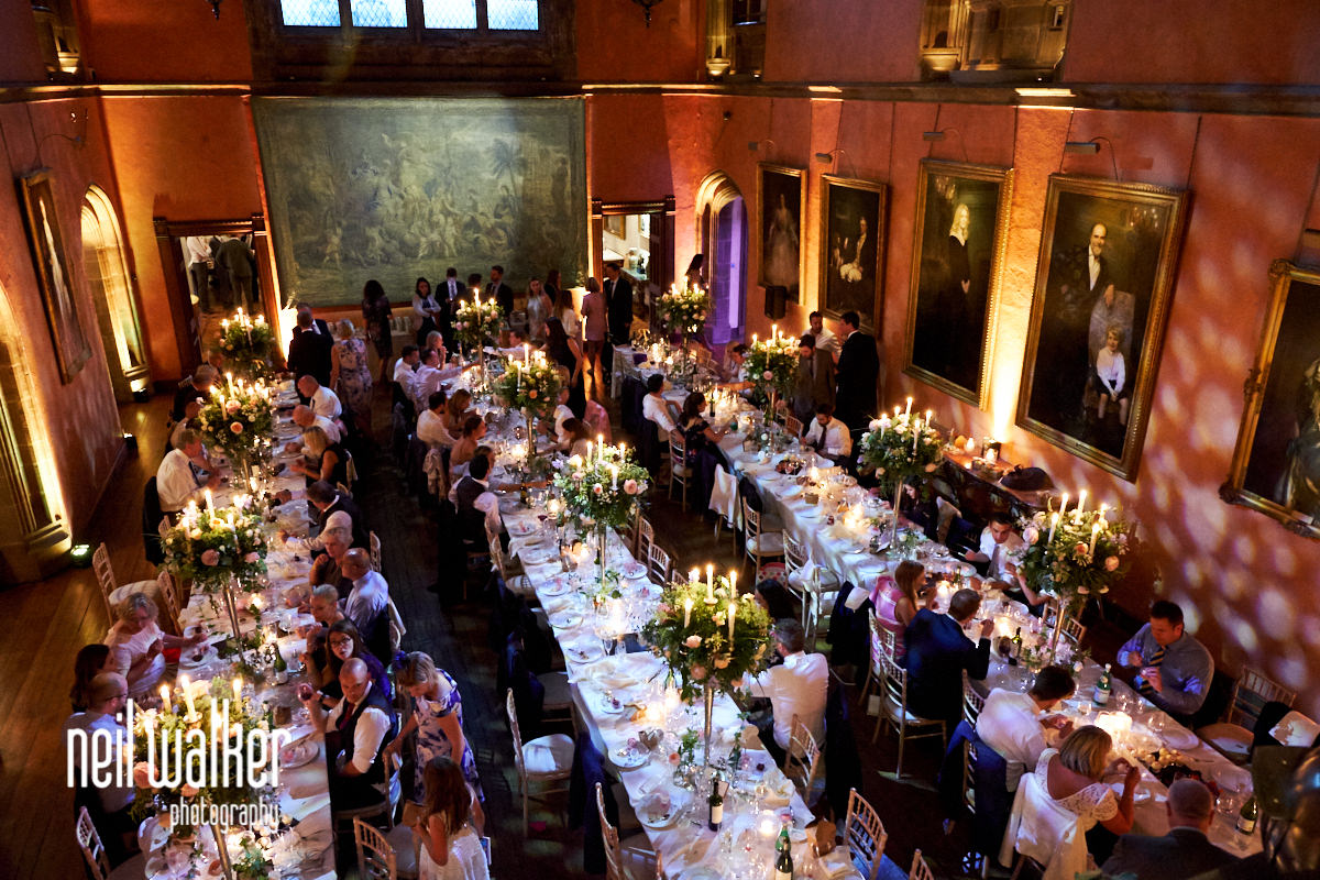 evening in the main hall at Cowdray House during a wedding