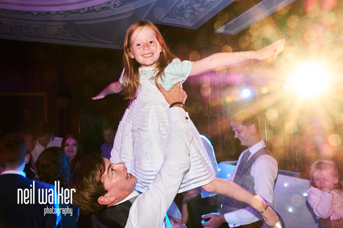 a little girl dancing during a wedding at Cowdray House