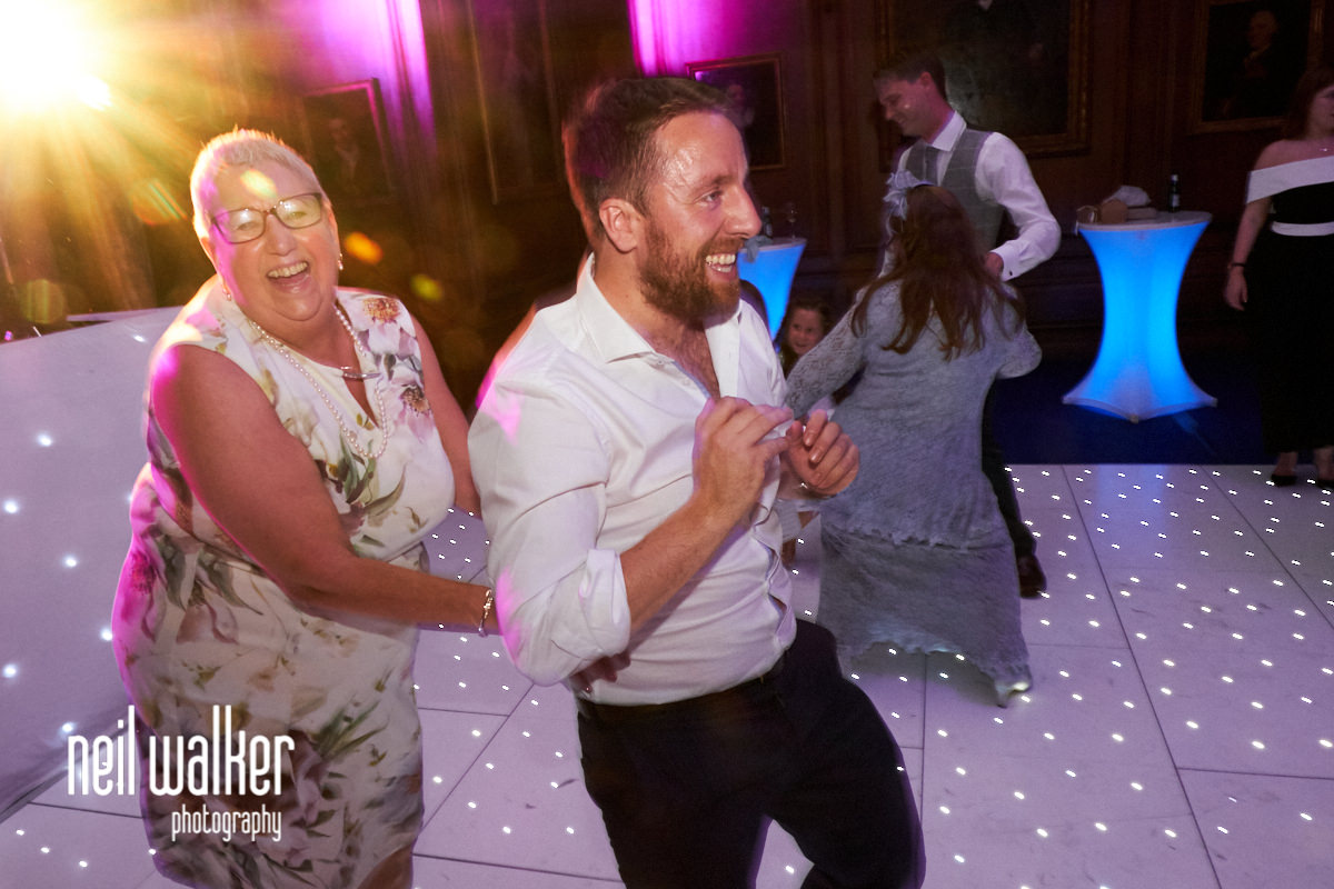 guests laughing and dancing at a wedding
