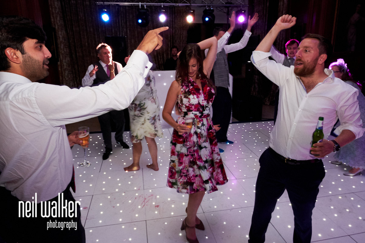 guests dancing and cheering at a wedding