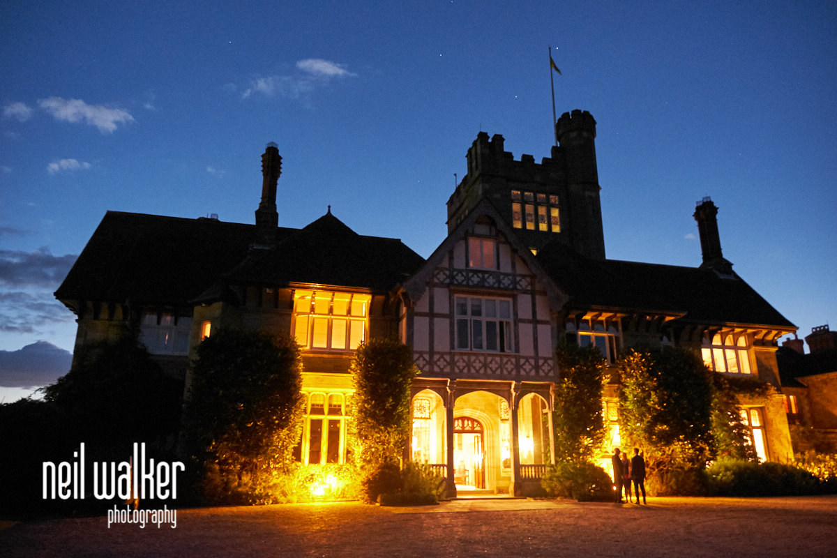 the front exterior of Cowdray House at dusk