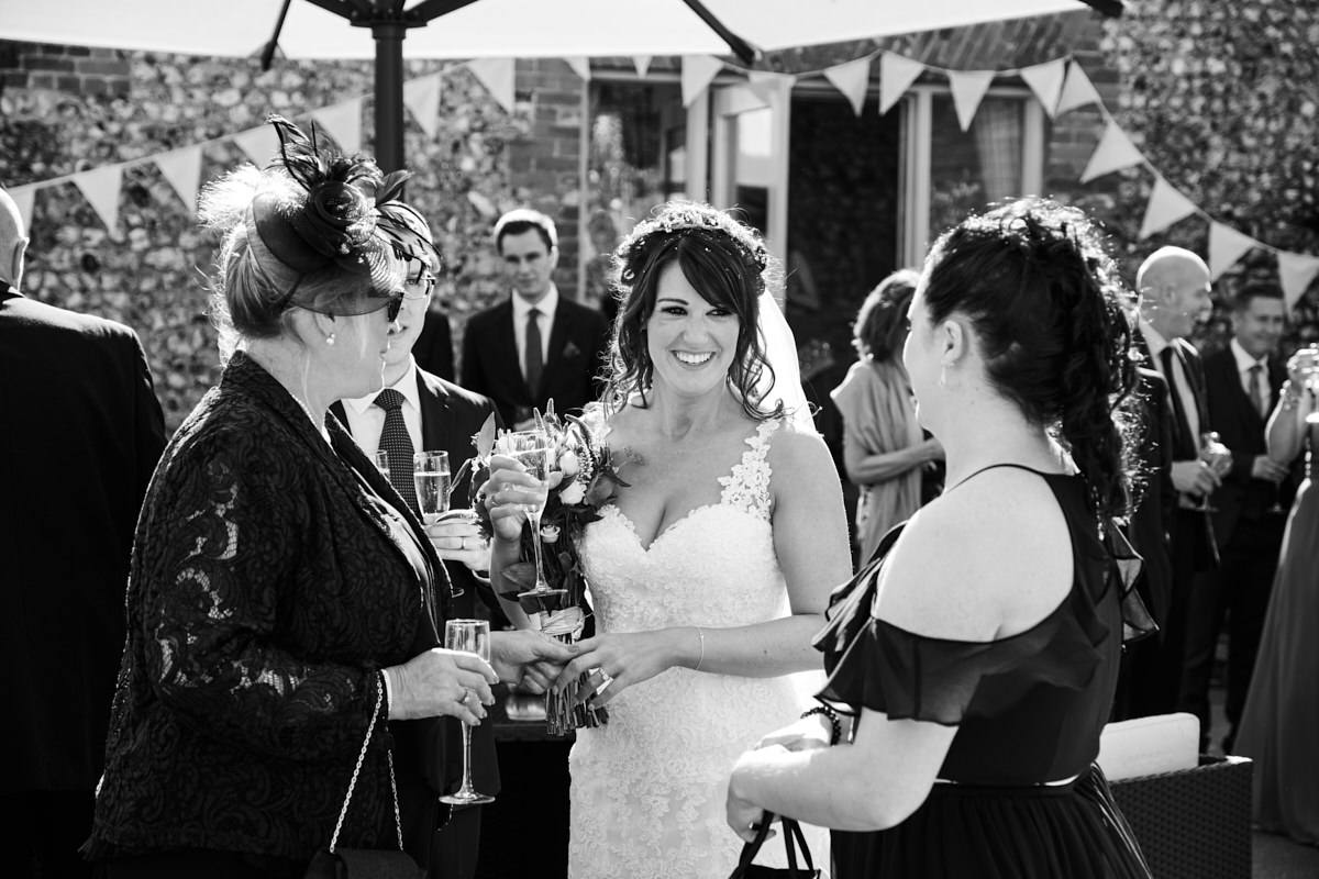 a bride talking to guests at a West Sussex wedding