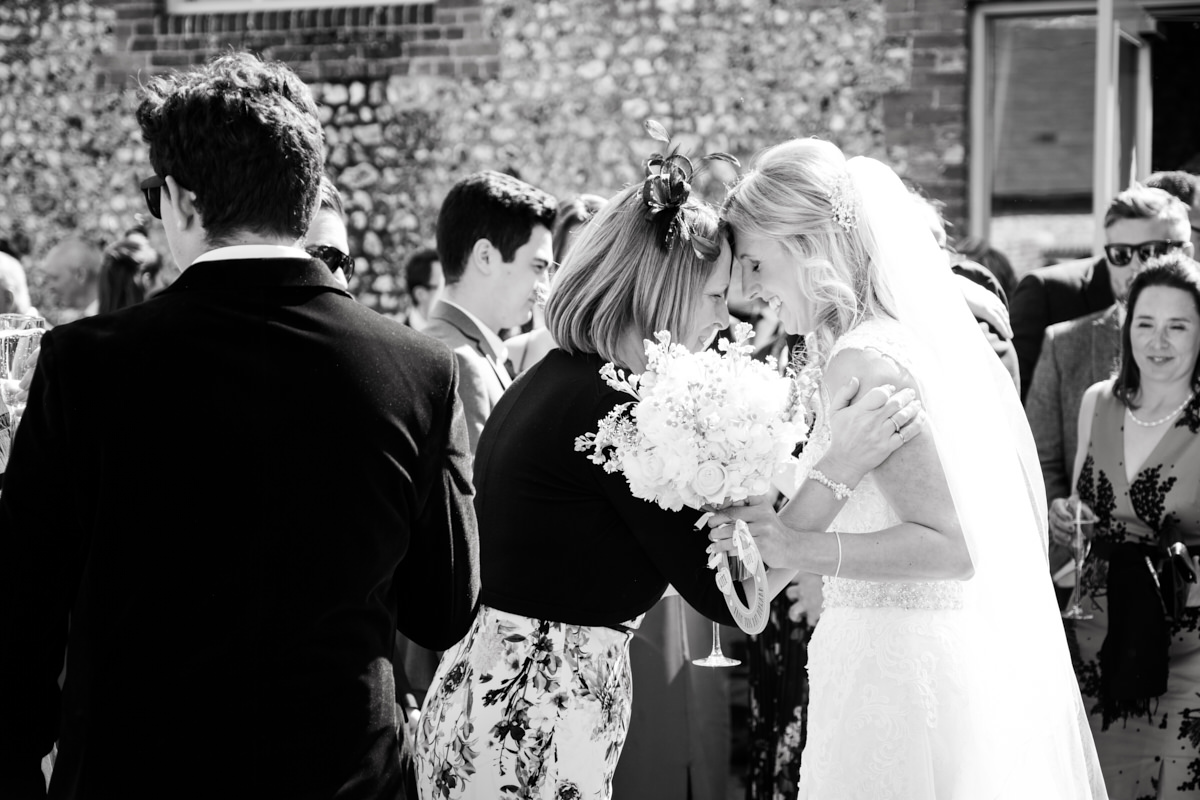 a bride having a moment with a relative during the reception for her West Sussex wedding