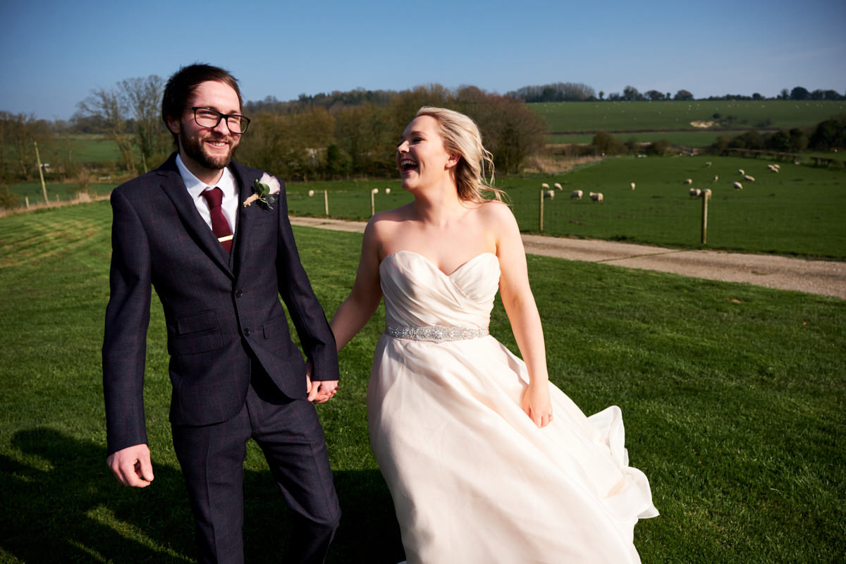 a bride and groom walking together at Farbridge, a West Sussex wedding venue