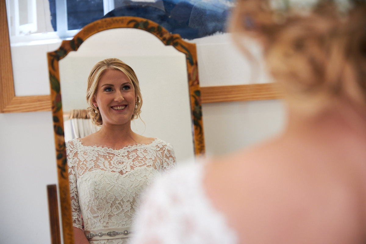 the bride photographed in a mirror