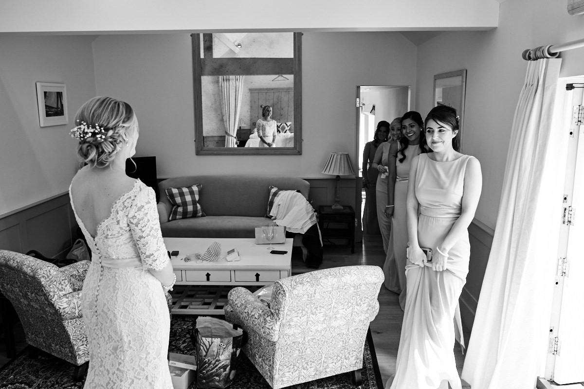 the bridesmaid's seeing the bride's dress for the first time