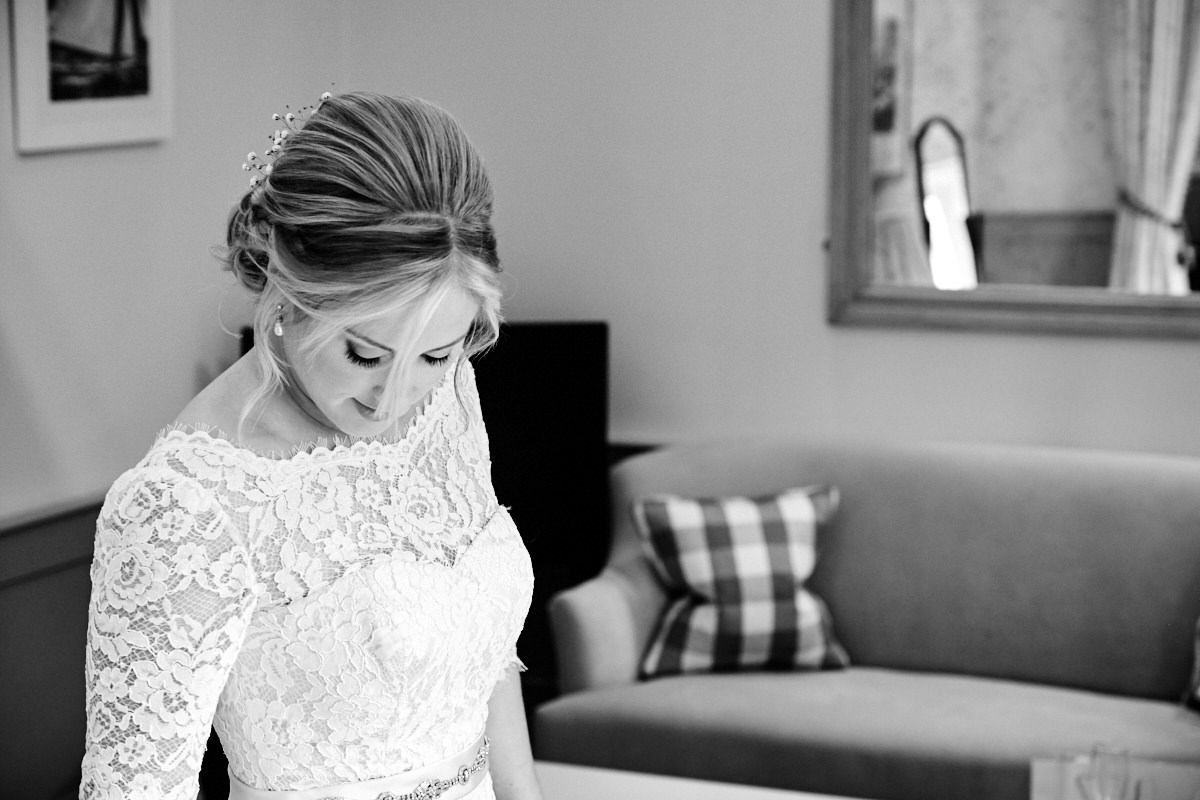 the bride getting ready for her barn wedding