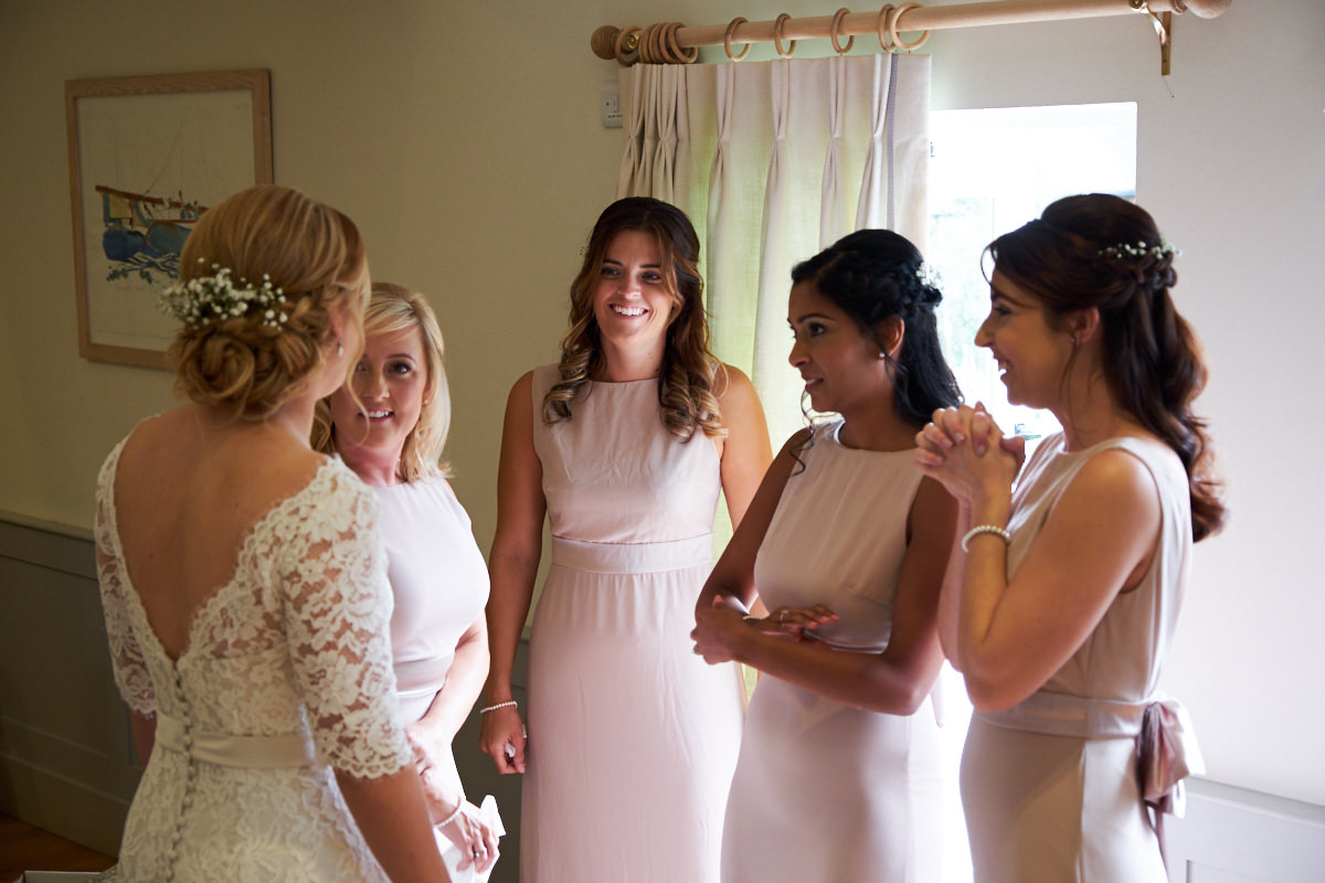 the bride and her bridesmaids in the bridal suite before they go to the main ceremony barn