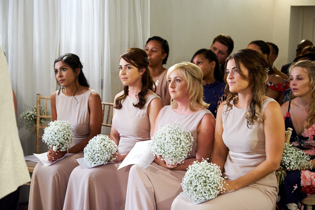 the bridesmaids during the wedding ceremony