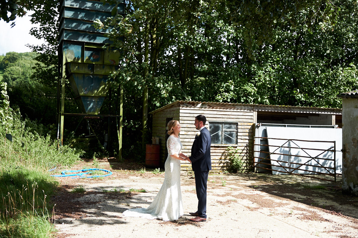 the bride and groom in a farmyard