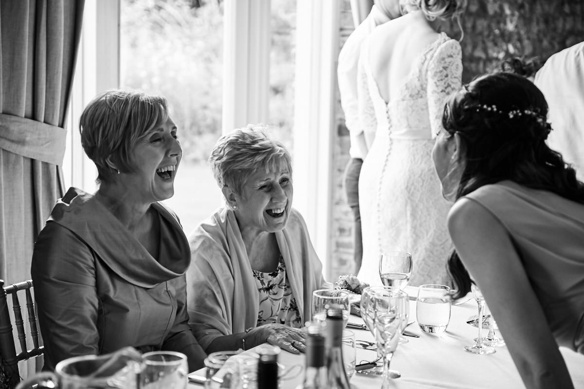 the bride's mother and grandmother laughing