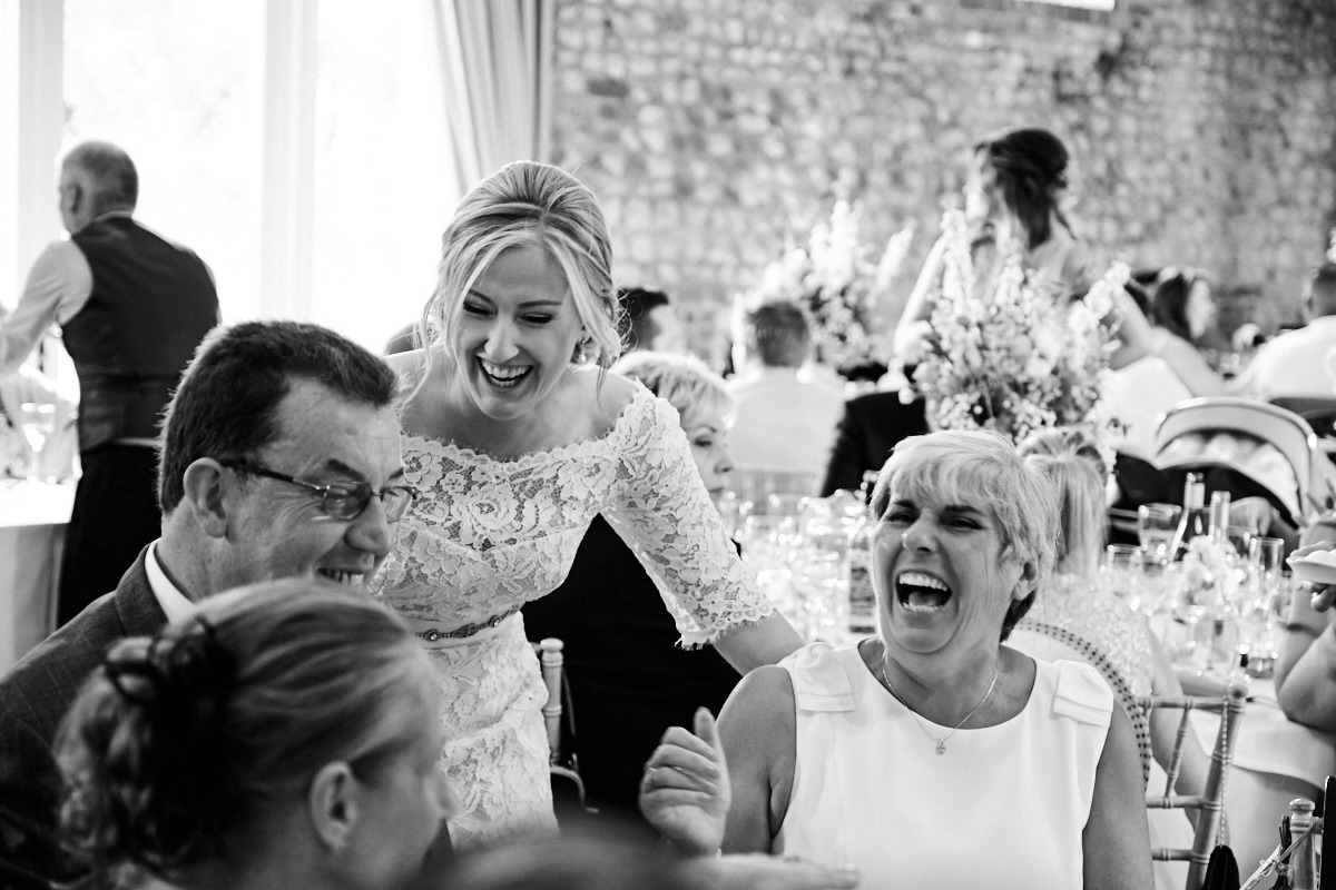 guests laughing at a barn wedding in Sussex