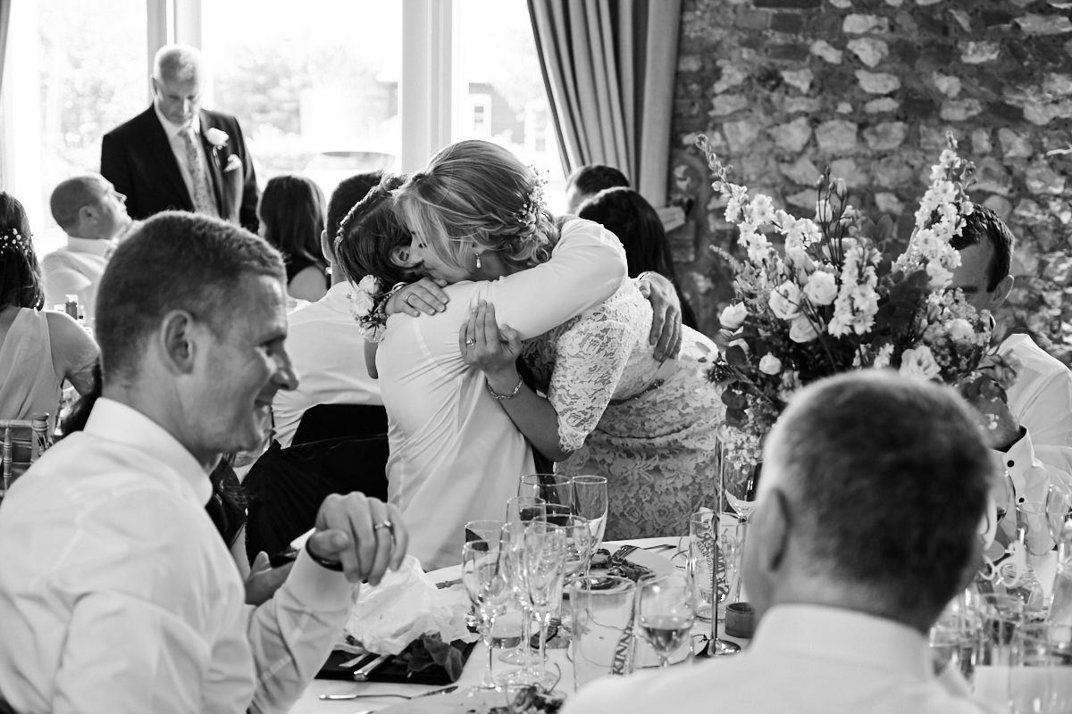 the bride hugging a guest