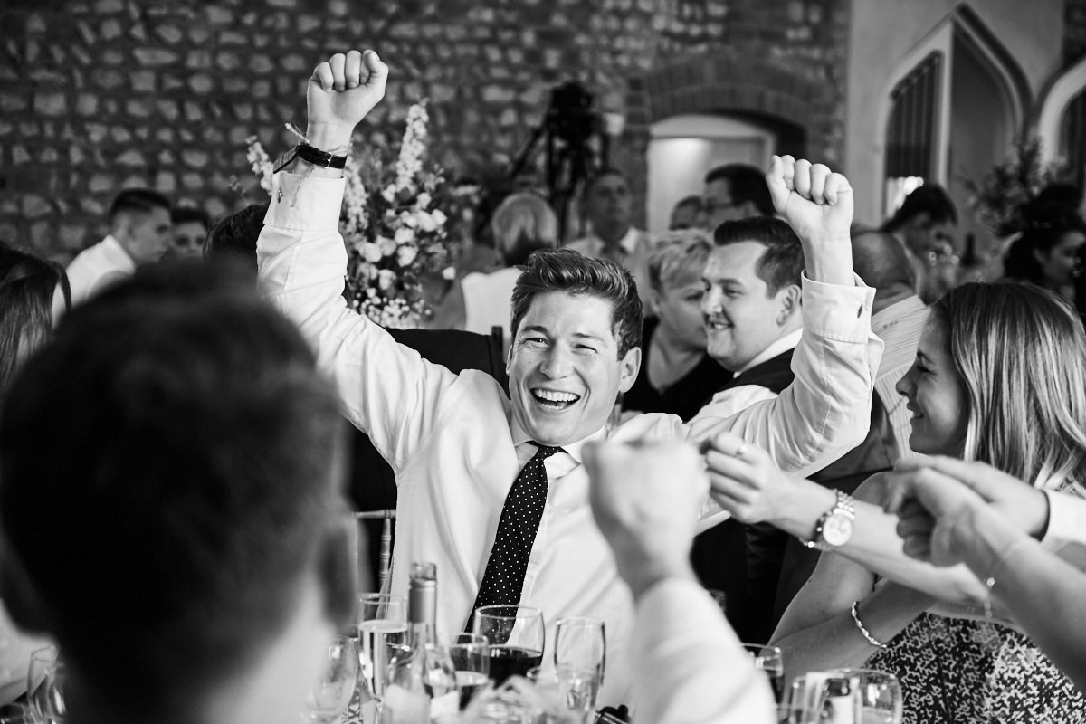a guest cheering at the father of the bride's speech