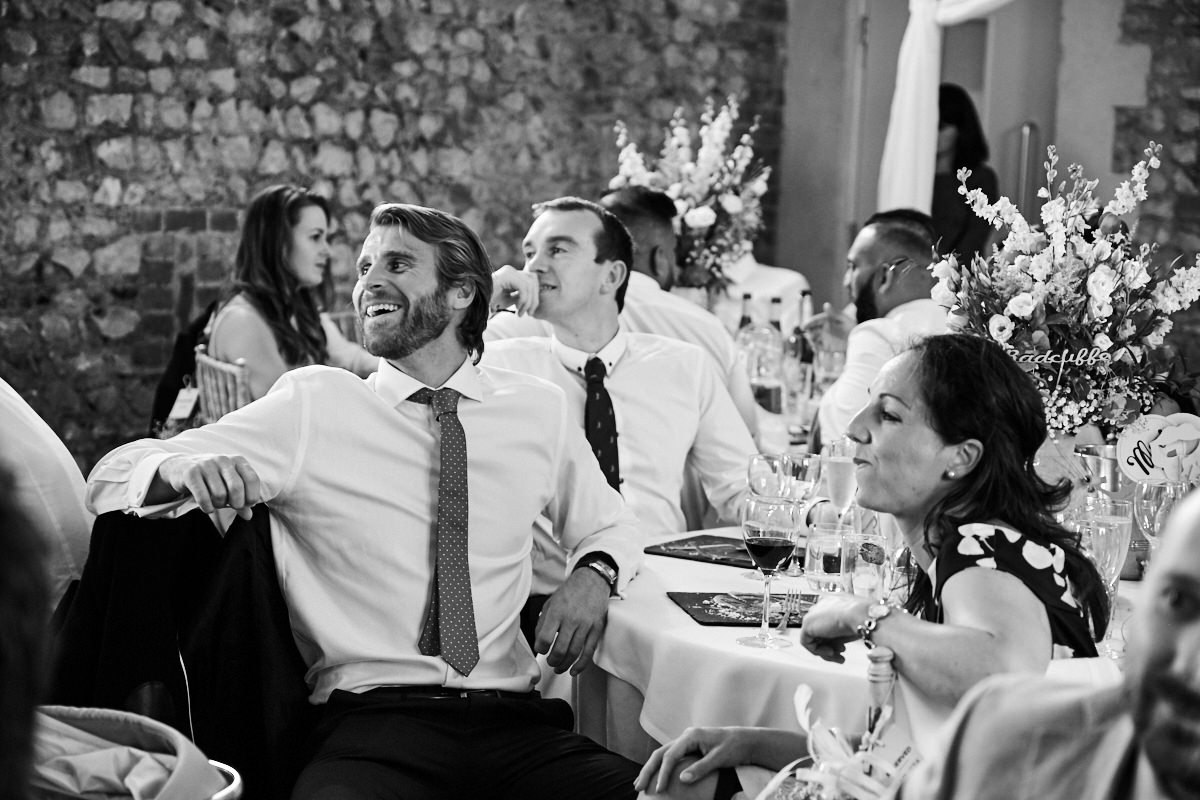 a guest laughs at this barn wedding