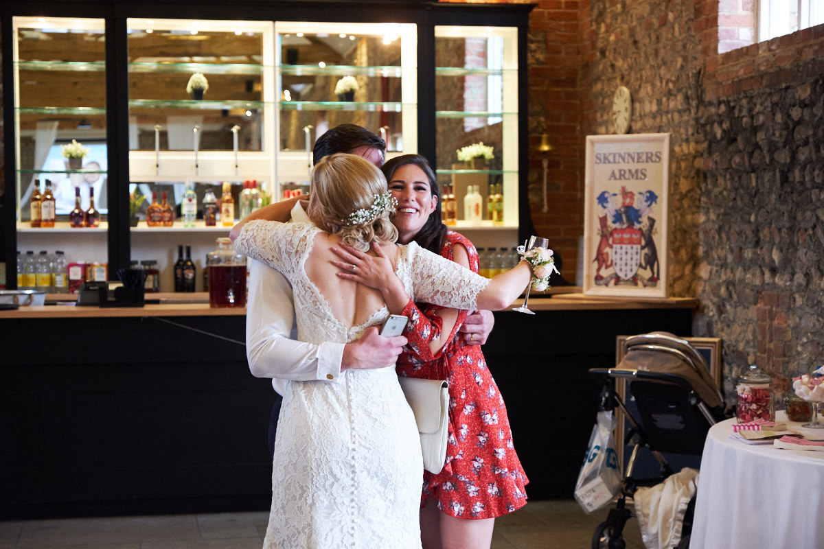 the bride hugs some guests