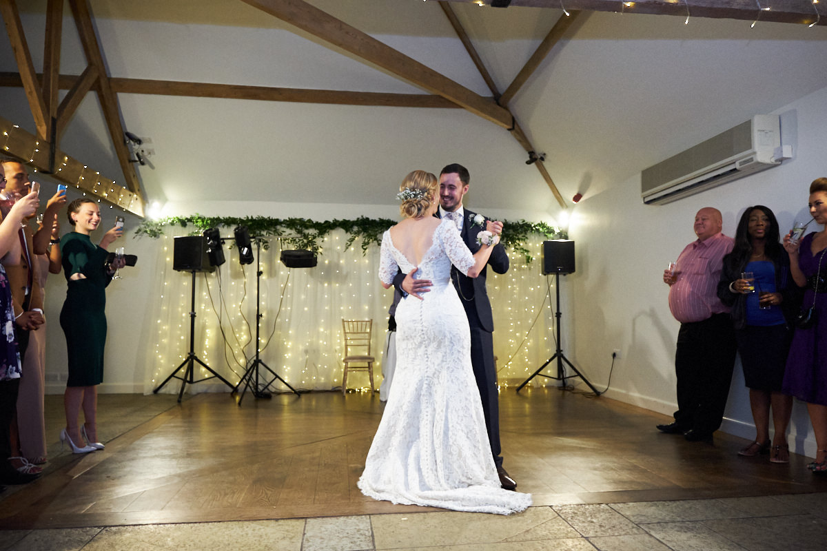 the bride and groom do their first dance at Farbridge barn