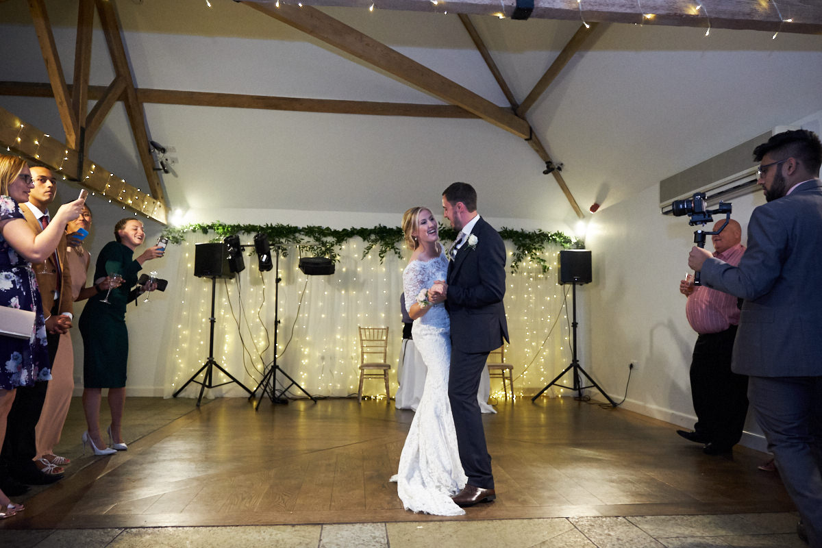 the bride and groom's first dance at this barn wedding