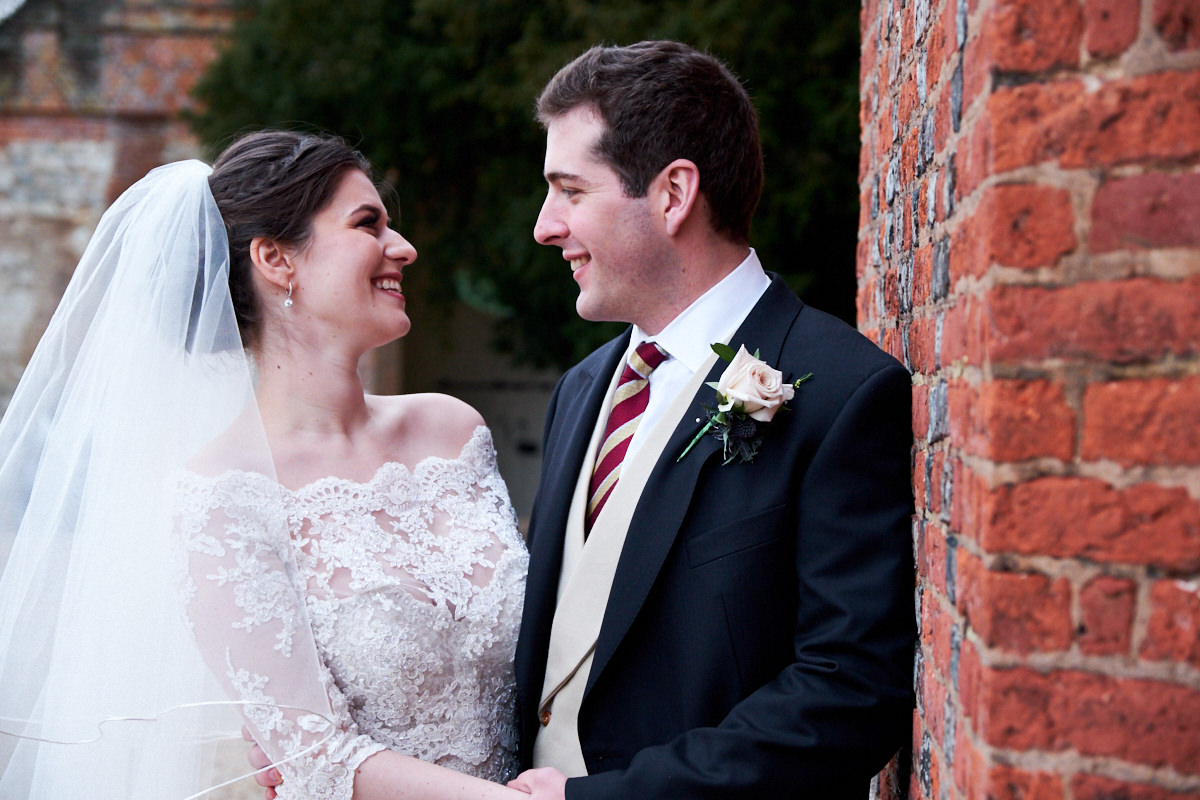 a bride and groom enjoy their wedding day at Farnham Castle