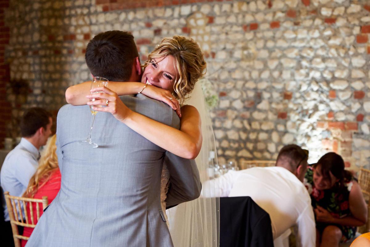 a bride hugging her brother
