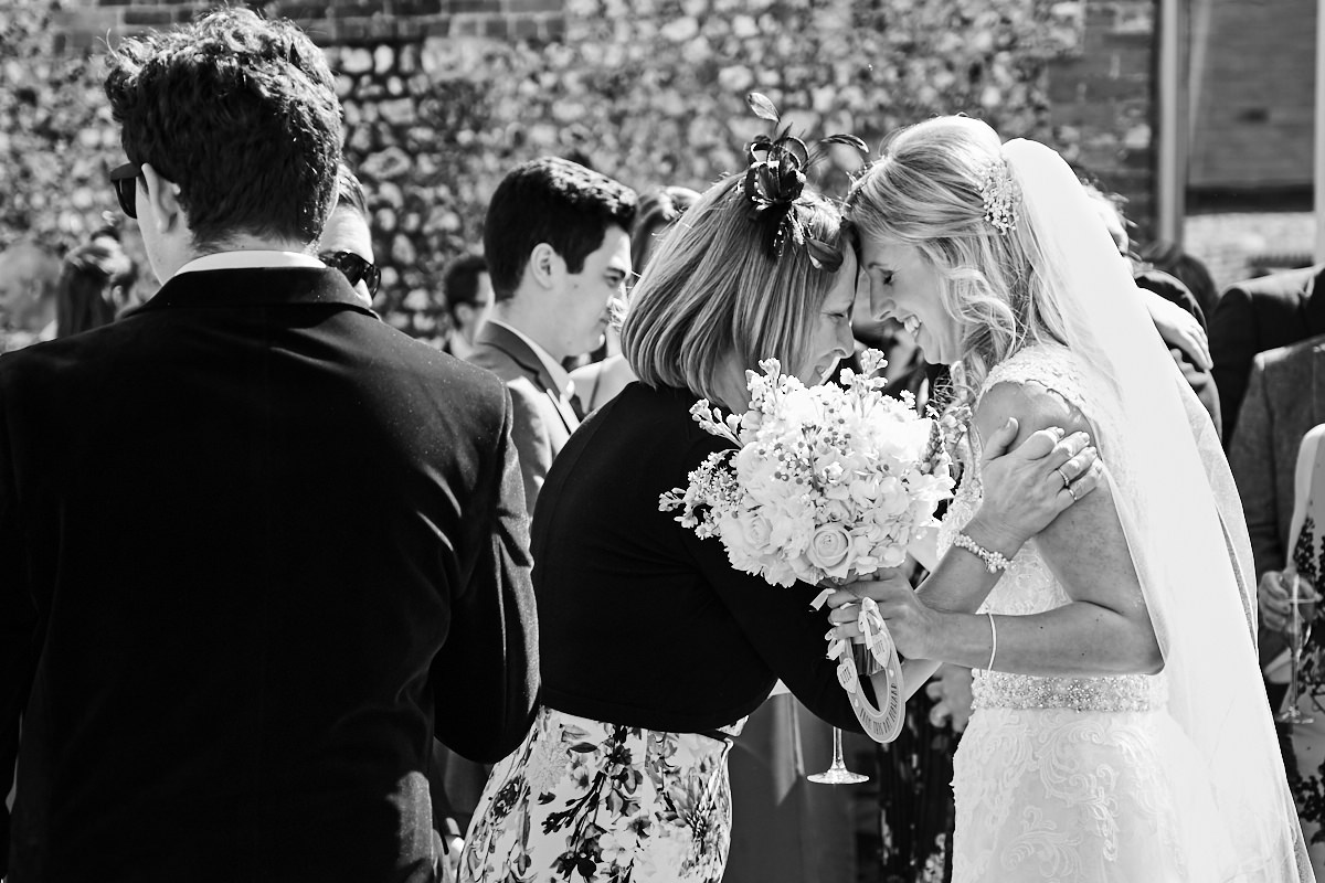 a bride having a moment with her mother at her wedding in Sussex