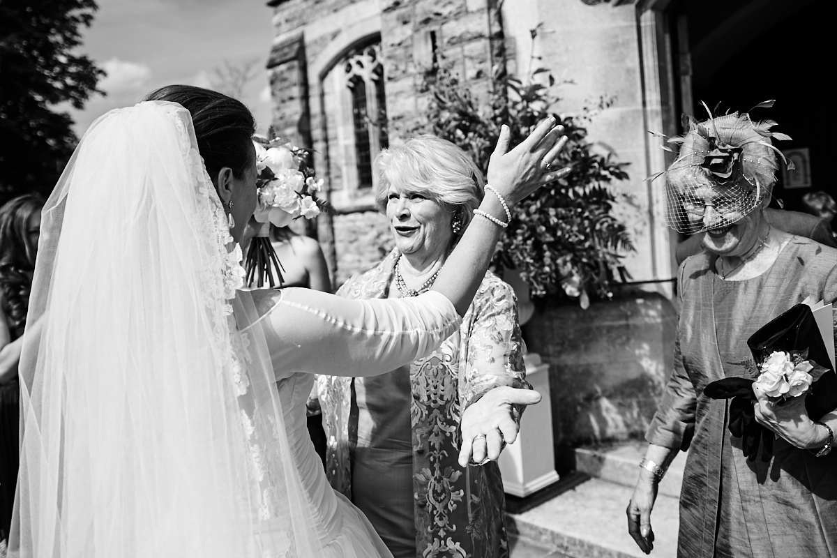 the mother of the bride congratulates her daughter after her wedding ceremony