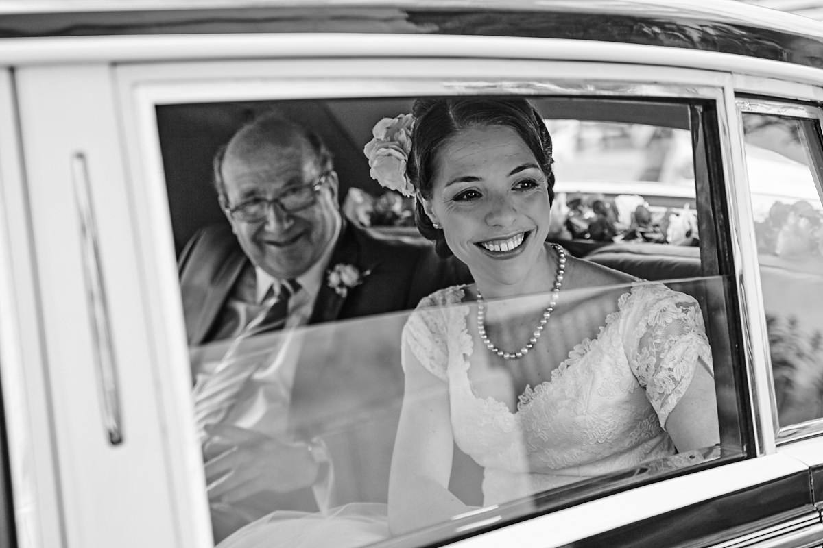 a bride arriving at the marriage venue in her wedding car
