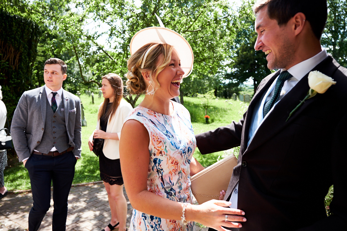 a guest greeting the groom at his wedding in Sussex