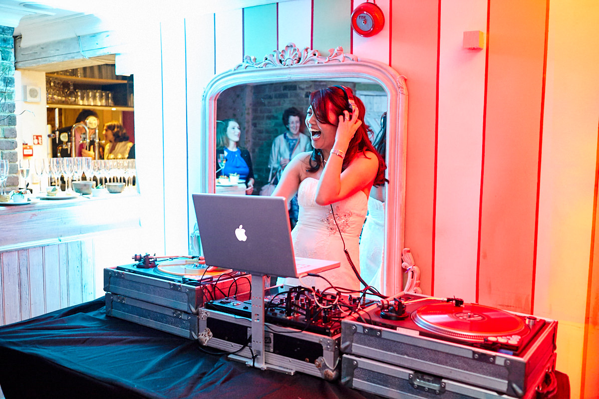a bride choosing the music at her wedding