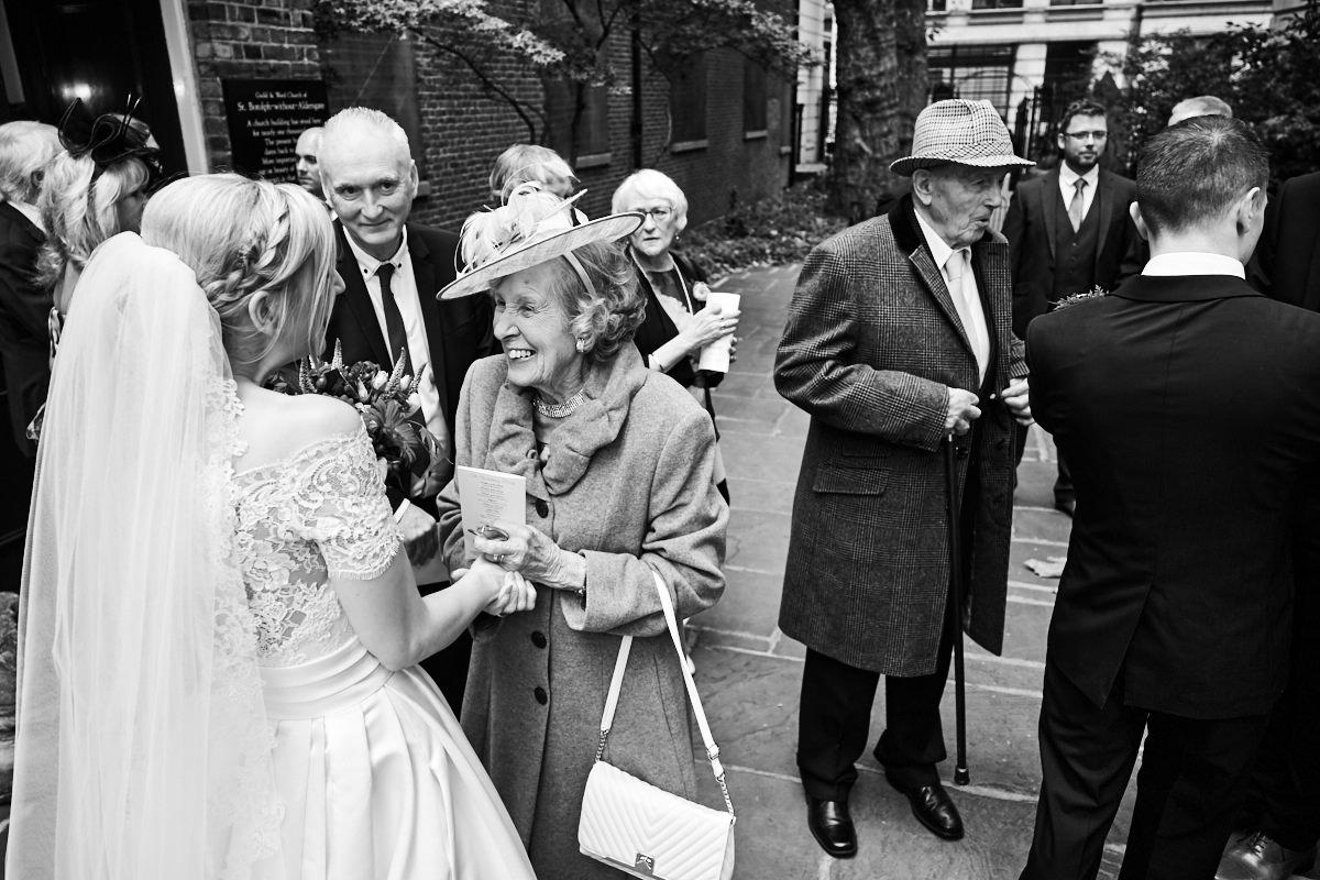 the bride's grandmother congratulates her