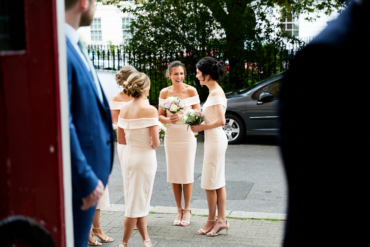 bridesmaids outside the church waiting for the bride